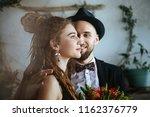 a stylish bride in a black...   Shutterstock . vector #1162376779