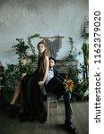 a stylish bride in a black...   Shutterstock . vector #1162379020