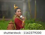 lao girl dressed in traditional ... | Shutterstock . vector #1162379200