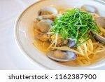 spaghetti alle vongole bianco...   Shutterstock . vector #1162387900
