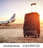 suitcase and airport background ... | Shutterstock . vector #1162394710