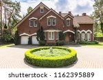 front view of a red brick... | Shutterstock . vector #1162395889