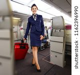 stewardess woman in plane  | Shutterstock . vector #1162396990