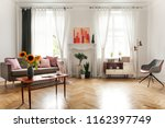 sunflowers on wooden table next ... | Shutterstock . vector #1162397749