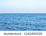 water wave in tropical sea for... | Shutterstock . vector #1162403320