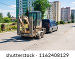 car is transporting a mini... | Shutterstock . vector #1162408129