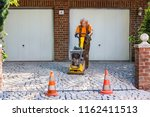 builder or contractor laying... | Shutterstock . vector #1162411513