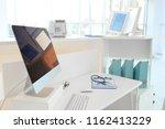 computer on reception desk in... | Shutterstock . vector #1162413229