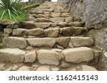 ancient stone staircase in the... | Shutterstock . vector #1162415143