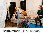 santa claus and snow maiden... | Shutterstock . vector #1162420906