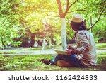 asian man travel nature. travel ... | Shutterstock . vector #1162424833
