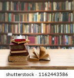 pile of old books | Shutterstock . vector #1162443586