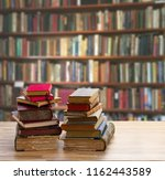 pile of old books | Shutterstock . vector #1162443589