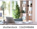 comfortable workplace with... | Shutterstock . vector #1162448686