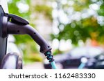 electric car photo in uk with... | Shutterstock . vector #1162483330