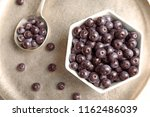 bowl with fresh acai berries on ... | Shutterstock . vector #1162486039