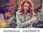 ginger woman in autum clothes ... | Shutterstock . vector #1162506076