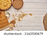 wheat in a plate board wooden... | Shutterstock . vector #1162530679