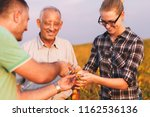group of farmers standing in a... | Shutterstock . vector #1162536136