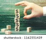 Small photo of businessman removes a cube with a picture of dollars. financial and economic crisis. capital outflow. sabotage of the economy. bankruptcy. pressure on small businesses. falling prices. cash loss