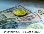 yellow coin bitcoin against the ... | Shutterstock . vector #1162552030