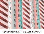 an unusual pink multi storey... | Shutterstock . vector #1162552990