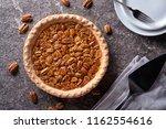 a delicious home made pecan pie ... | Shutterstock . vector #1162554616