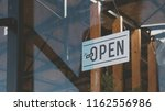 cu we are open sign hanging on...   Shutterstock . vector #1162556986