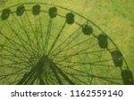 shadow of ferris wheel ...   Shutterstock . vector #1162559140