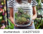 midsection of florist holding... | Shutterstock . vector #1162571023