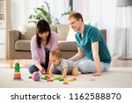 family  parenthood and people... | Shutterstock . vector #1162588870