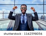 happy lucky and successful afro ... | Shutterstock . vector #1162598056