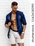 hot male model with six pack... | Shutterstock . vector #1162618390