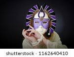 actress in a theatrical mask... | Shutterstock . vector #1162640410