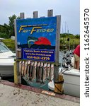 Small photo of Leland, Michigan - August 7, 2018: Board displaying the afternoon's catch of Lake Trout caught on Far-Fetched Charter in the fishing village of Leland.
