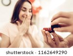 a guy gives a ring to...   Shutterstock . vector #1162649290