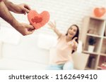 guy makes a gift to girlfriend...   Shutterstock . vector #1162649410