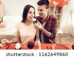 cheerful couple romantic dinner ...   Shutterstock . vector #1162649860