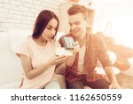 guy makes a gift to girlfriend...   Shutterstock . vector #1162650559