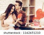 couple holding red heart...   Shutterstock . vector #1162651210