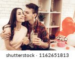 a guy and a girl romantic kiss...   Shutterstock . vector #1162651813