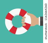 hand holding a lifebuoy on... | Shutterstock .eps vector #1162664260