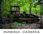old crawler tractor in the... | Shutterstock . vector #1162665316
