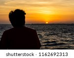 Silhouette Of A Lonely Man Are...