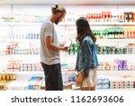 young beautiful couple... | Shutterstock . vector #1162693606