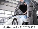 modern certified car service.... | Shutterstock . vector #1162694539