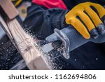 Reciprocating Saw Closeup Photo. Power Tool Wood Cutting. Construction Industry.  - stock photo