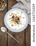 bowl with yoghurt and granola... | Shutterstock . vector #1162721029