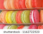 close up of color macaroons on... | Shutterstock . vector #1162722523