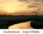 solitary tree close to a little ... | Shutterstock . vector #1162739686